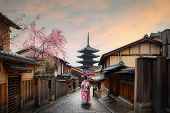Asian Young Woman Traveller Wearing Japanese Traditional Kimono With Red Umbrella Sightseeing At Fam poster