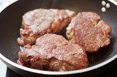 beef steak in a frying pan