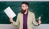 Teacher Bearded Man Hold Documents And Microscope Chalkboard Background. Biology Is His Passion. Dem poster