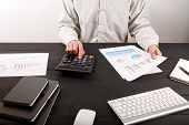 Close Up Of Man Accountant Or Banker Making Calculations. Close Up Of Man Accountant Or Banker Makin poster