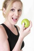 Happy Woman About To Eat An Apple