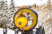 Yellow Snow Cannon Snow Maker Machine, Snow Gun For Production Of Snow On Ski Slopes poster