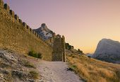 Sunset In The Mountains Of Crimea, Sudak. Genoese Fortress
