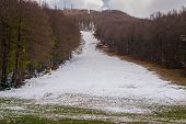 Ski Slope With Little Snow During Warm Winter. Greenhouse Effect Concept. Ski Resort Amiata Mountain poster