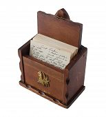 vintage brown wooden recipe box with handwritten recipes