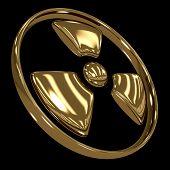 Radiation symbol made of gold isolated on black