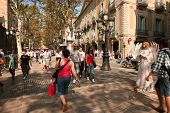 BARCELONA - OCTOBER, 5: Tourists strolling famous Ramblas on October 5, 2009 in Barcelona, Spain. Ra