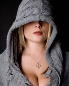 stock photo of cleavage  - Blonde in a hoody showing cleavage and red lips - JPG