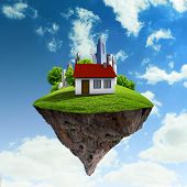 Little fine island / planet. A piece of land in the air. Lawn with house and tree. Pathway in the gr