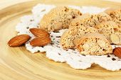 Aromatic cookies cantuccini on wooden plate close-up