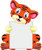 Cute tiger cartoon holding blank sign