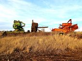 Three worn-out combines retire in the field