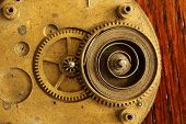 Detail Of Circular Brass Watch Clock Part With Spring And Gear