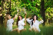 three friend girl playing on grass. outdoor shot