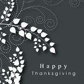 Beautiful Happy Thanksgiving Day celebration poster, banner or flyer with leaves and floral designs on grey background.