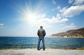 Man Stands On A Background Of Sea And Sun