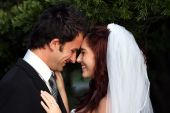 picture of wedding couple  - Happy wedding couple sharing an intimate moment - JPG
