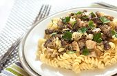 image of morels  - Spiral pasta with morel mushrooms and parsley leaves