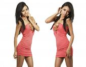 Beautiful young exotic women in pink dress isolated against white background.