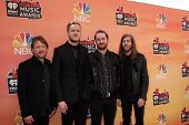 LOS ANGELES - MAY 1:  Ben McKee, Dan Reynolds, Daniel Platzman and Wayne Sermon, Imagine Dragons at the 1st iHeartRadio Music Awards at Shrine Auditorium on May 1, 2014 in Los Angeles, CA
