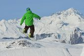 picture of snow-slide  - jumping skier at mountain winter snow fresh suny day - JPG