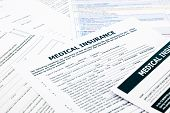stock photo of reimbursement  - medical insurance form paperwork and questionnaire for insurance concepts - JPG