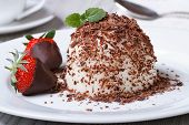 image of panna  - Italian dessert panna cotta with dark chocolate and strawberries close - JPG