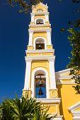 stock photo of playa del carmen  - Beautiful old Spanish church and bell tower near Playa del Carmen Mexico - JPG
