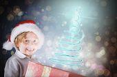 Festive boy opening gift against dark abstract light spot design