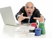 foto of spanish money  - desperate addict businessman on computer laptop loosing lots of money betting on internet poker with cards and chips on online gambling addiction isolated on white - JPG