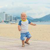 Baby walking along the beach