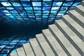 Grey steps against walls of digital screens in blue