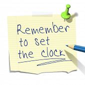 A sticky paper with the message remember to set the clock