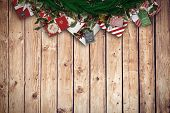 Festive christmas wreath against wooden planks background