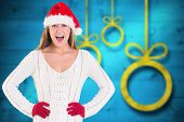 Festive blonde shouting at camera against blurred christmas background