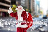 Santa claus ringing bell against new york street