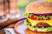 image of hamburger  - Tasty and appetizing hamburger cheeseburger - JPG