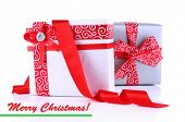 Holiday gift boxes decorated with red ribbon isolated on white