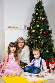 Happy Mother And Two Her Children In Christmas