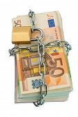 euro banknotes with chain and padlock. symbol photo for security and inflation.