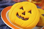 closeup of a pile of cookies in the shape of jack-o-lanterns