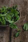 Food. Spinach on a wooden table