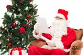 christmas, holidays and people concept - man in costume of santa claus with letter