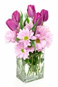 stock photo of get well soon  - A Spring flower arrangement of daisies and tulips in a rectangular glass vase - JPG