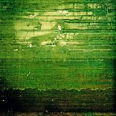 Dirty and weathered old textured background. With yellow, green patterns