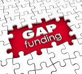 Gap Funding 3d words in a hole in puzzle pieces illustrating financial need or shortfall that must be met to continue operations