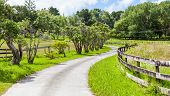 A Less-traveled Road Winds Through The Farmland.