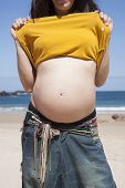 Pregnant Woman Showing Navel