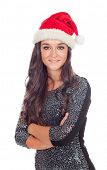 Attractive brunette girl with Christmas hat isolated on a white background