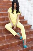 Beautiful Woman With Black Hair In Elegant Yellow Suit